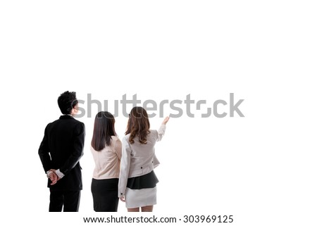 Back View of Three Asian Business People Looking Something