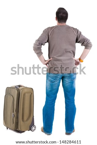 Back view of traveling man with suitcase looking up. Rear view people collection.  backside view of person.  Isolated over white background.  - stock photo