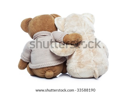 Back view of two Teddy bears hugging each other over white - stock photo