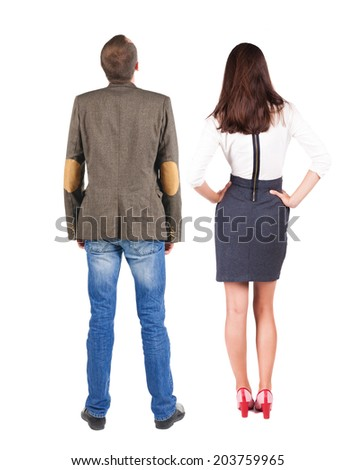 Back view of two young business people hug and look into the distance. Rear view. Isolated over white background. young woman holds the hand of her husband looking away - stock photo