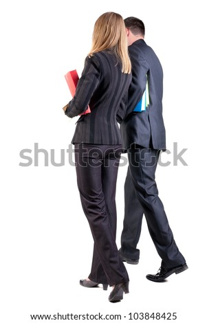 Back view of walking business team. Going young couple (man and woman) with books. girl and guy in suit together. Rear view people collection. backside view of person. Isolated over white background - stock photo