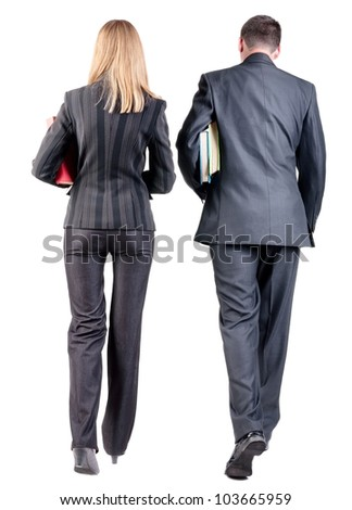 Back view of  walking business team. Going young couple (man and woman) with books.   Rear view people collection.  backside view of person.  Isolated over white background. - stock photo