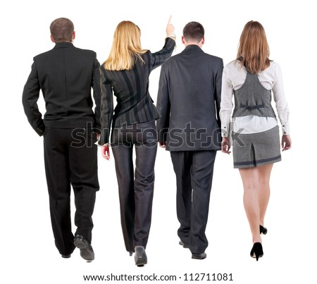 back view of walking business team. group of businesspeople in suit going. woman pointing in distance. Rear view people collection. backside view of person. Isolated over white background.