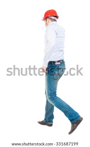 Back view of walking engineer in helmet.  Rear view people collection. Backside view of person. Isolated over white background. - stock photo
