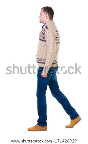 Back view of walking handsome man in jeans and warm sweater.  young guy going . Rear view people collection.  backside view of person.  Isolated over white background.