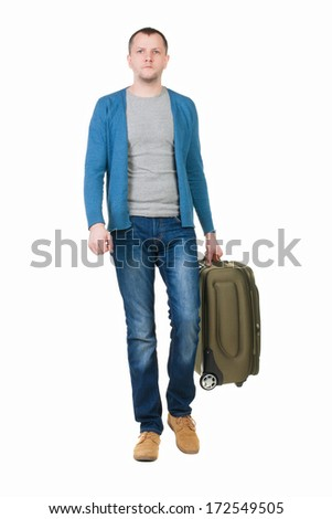 back view of walking  man  with suitcase. brunette guy in motion. backside view person. Rear view people collection. Isolated over white background. young man goes to side rolling travel bag on wheels - stock photo