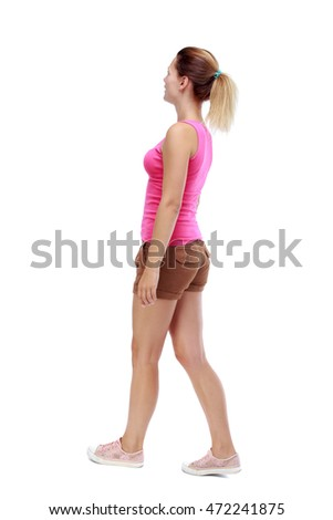 back view of walking  woman. beautiful blonde girl in motion.  backside view of person.  Rear view people collection. Isolated over white background. Sport blond in brown shorts goes diagonally.