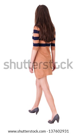 back view of walking  woman. beautiful brunette girl in motion.  backside view of person.  Rear view people collection. Isolated over white background. girl in a dress walks forward - stock photo