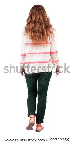 back view of walking  woman . beautiful redhead girl in motion.  backside view of person.  Rear view people collection. Isolated over white background. A girl with flying red hair walks past us - stock photo