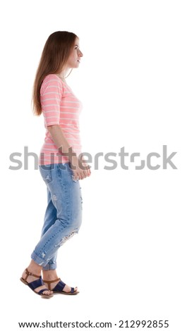 back view of walking  woman . beautiful redhead girl in motion.  backside view of person.  Rear view people collection. Isolated over white background.  - stock photo