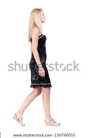 back view of walking woman . going gir in motion. Rear view people collection.  backside view of person. Isolated over white background. - stock photo