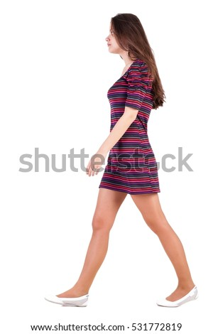 back view of walking  woman in dress. beautiful brunette girl in motion. backside view of person. Rear view people collection. Isolated over white background. Sad brunette goes past us