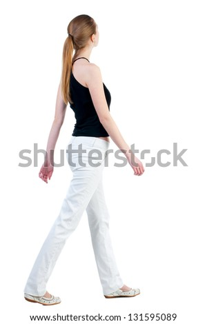 back view of walking  woman in  in white trousers and shirt. beautiful blonde girl in motion.  backside view of person.  Rear view people collection. Isolated over white background. - stock photo
