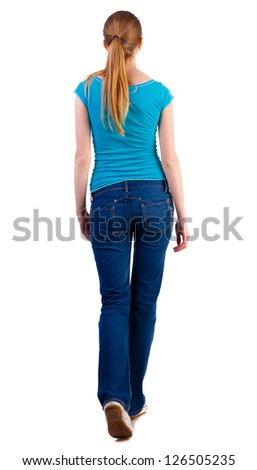 back view of walking  woman  in   jeans and shirt. beautiful blonde girl in motion.  backside view of person.  Rear view people collection. Isolated over white background. - stock photo