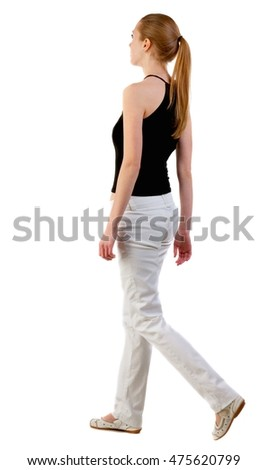 back view of walking  woman  in  white jeans and shirt. beautiful blonde girl in motion.  backside view of person.  Rear view people collection. Isolated over white background.