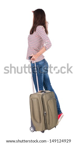 back view of walking  woman  with suitcase. beautiful  girl in motion.  backside view of person.  Rear view people collection. Isolated over white background. traveling teen girl