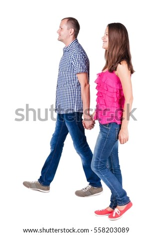 Back view of walking young couple man and woman . going beautiful friendly girl and guy together. Rear view people collection. backside view of person. Isolated over white background