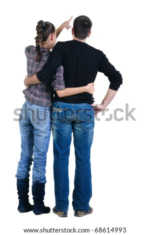 Back view of watching young couple pointing at wall. Rear view. Isolated over white background. - stock photo