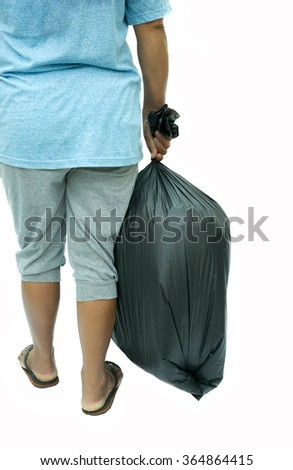 Back view of woman holding a black garbage bag in white background - stock photo