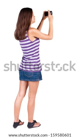 Back view of woman photographing.   girl photographer in dress. Rear view people collection.  backside view of person.  Isolated over white background. - stock photo