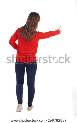 Back view of  woman thumbs up. Rear view people collection. backside view of person. Isolated over white background. slender blonde in a jeans shows the symbol of success or hitchhiking - stock photo