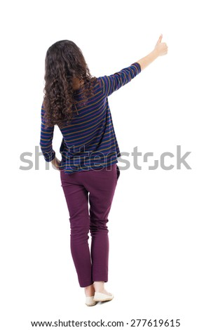 Back view of  woman thumbs up. Rear view people collection. backside view of person. Isolated over white background. Thrusting one hand in the pocket of the second girl shows gesture - stock photo