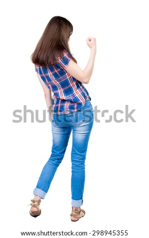 Back view of  woman thumbs up. Rear view people collection. backside view of person. Isolated over white background.  A young girl in a checkered blue with red stripes make right hand gesture success. - stock photo