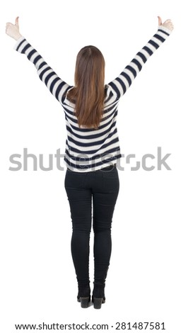 Back view of  woman thumbs up. Rear view people collection. backside view of person.slender blonde in a jeans shows the symbol of success or hitchhiking. With both hands, hand girl shows thumbs.  - stock photo