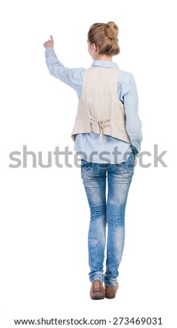 back view of woman. Young woman in vest presses down on something. Isolated over white background. Rear view people collection. backside view of person. she holds his hand open, palm forward - stock photo