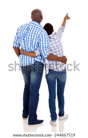 back view of young african american couple pointing isolated on white - stock photo