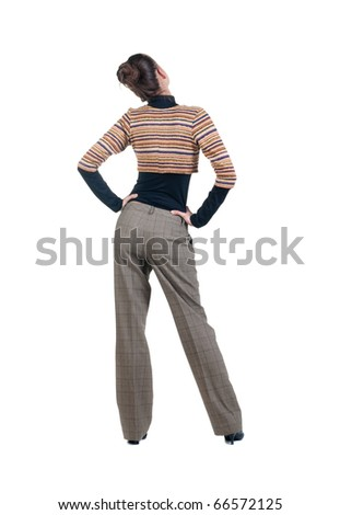 Back view of young Beautiful business woman looking at wall. Rear view. Isolated over white background . - stock photo