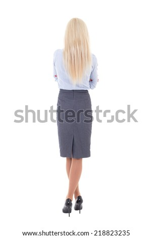 back view of young beautiful woman in business suit isolated on white background - stock photo
