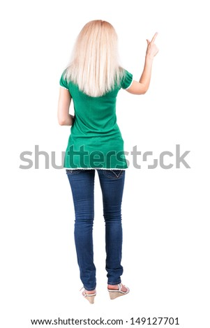 Back view of young blonde woman pointing at wall. beautiful girl in green dress. Rear view people collection. backside view of person. Isolated over white background. - stock photo