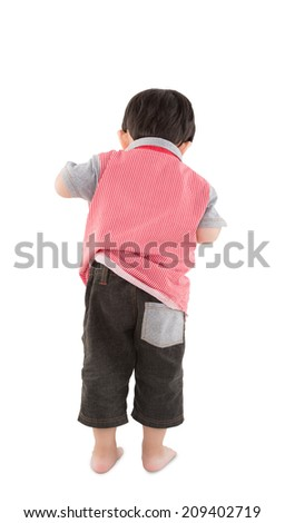 Back view of young boy looking over white background - stock photo