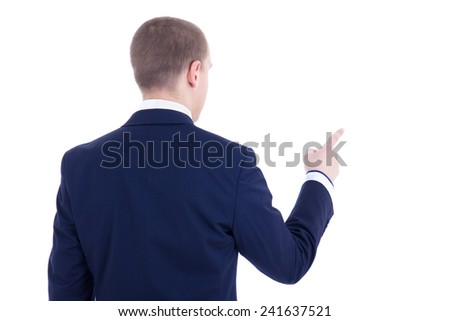 back view of young business man pointing at something isolated on white background - stock photo