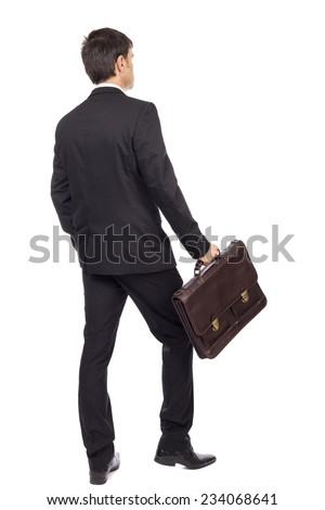 Back view of young businessman with  briefcase walking isolated over white background - stock photo