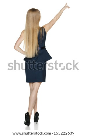 Back view of young businesswoman in full length pointing at blank copy space, isolated on white - stock photo