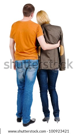 Back view of young couple (man and woman) hug and look into the distance. beautiful friendly girl and guy together. Rear view people collection.  backside of person.  Isolated over white background