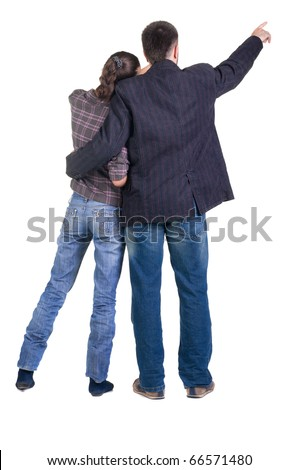 Back view of young couple pointing at wall. Rear view. Isolated over white background. - stock photo