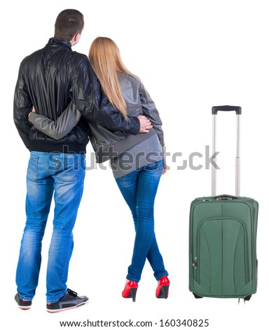 Back view of young couple traveling with suitcas . beautiful friendly girl and guy together. Rear view. Isolated over white background. - stock photo