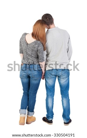 Back view of young embracing couple  hug and look into distance. beautiful friendly girl and guy together. Rear view people collection.  backside view of person.  Isolated over white background.