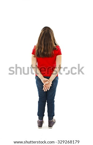 Back view of young girl looking at wall. Rear view. Isolated on white background  - stock photo