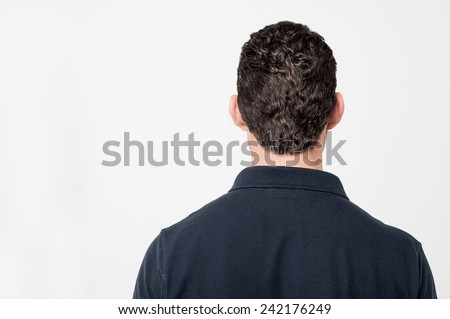 Back view of young man isolated over white - stock photo