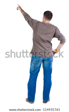 Back view of young man pointing at wall. Rear view people collection.  backside view of person.  Isolated over white background. - stock photo
