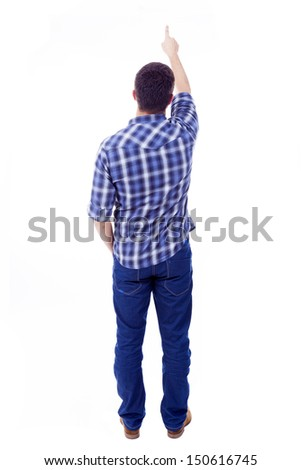 Back view of young man pointing up, isolated over white background - stock photo