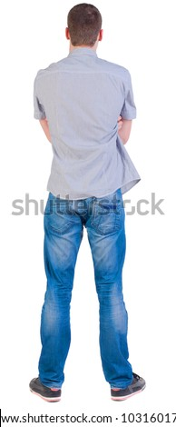 Back view of young men in  shirt and jeans.  Guy  looks away. Rear view people collection.  backside view of person.  Isolated over white background.
