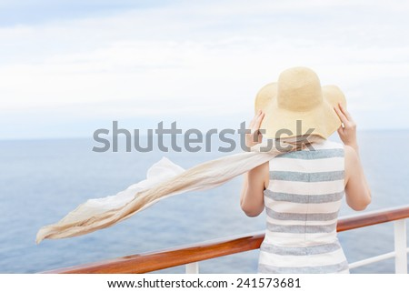 back view of young woman enjoying cruise - stock photo