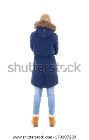 back view of young woman in winter clothes isolated on white background - stock photo