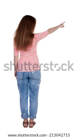Back view pointing woman. beautiful redhaired girl . Rear view people collection.  backside view person.  Isolated over white background. Girl in white T-shirt points a finger at something interesting - stock photo