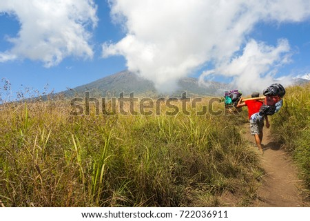 back view porter mount rinjani carry load
